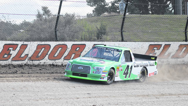 Ben Rhodes of Louisville, Ky., had the fastest qualifying lap Wednesday night for the 6th annual Eldora Dirt Derby NASCAR Camping World Truck Series 150 race at Eldora Speedway in Rossburg. His lap time was 20.737 seconds reaching a speed of 86.801 mph. Rhodes recently won the Buckle Up In Your Truck 225 last Thursday at Kentucky Speedway. Race results for the Dirt Derby 150 were not available by press time. See Friday's Daily Advocate for more on this event.