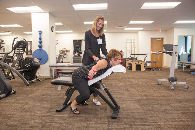 Physical Therapist Brooke Alberts assists a patient in the new therapy space at the Upper Valley Medical Center satellite facility in Piqua.