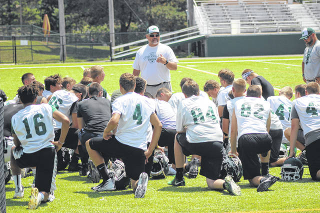 Greenville football coach Aaron Shaffer talks with his players after Thursday's 7-on-7 practice with Brookville and St. Henry at Greenville High School's Harmon Field.