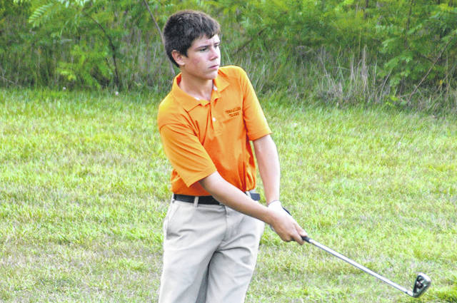 Versailles' Connor VanSkyock watches his ball during a 2017 golf match.