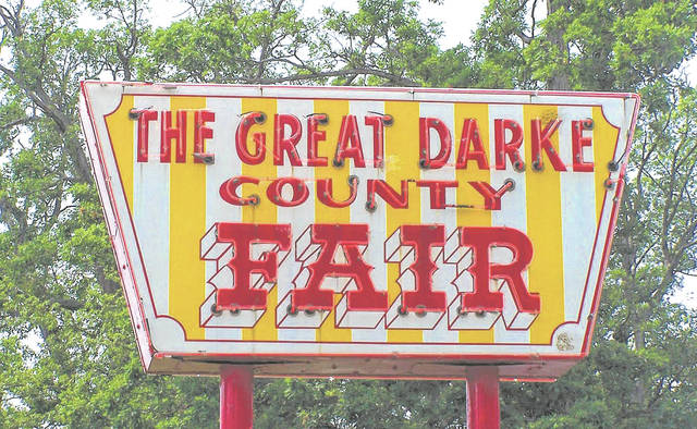 The Darke County Fair Board agreed to move this year's dog department events into a tent pending construction of a new dog barn at its monthly meeting Wednesday night.
