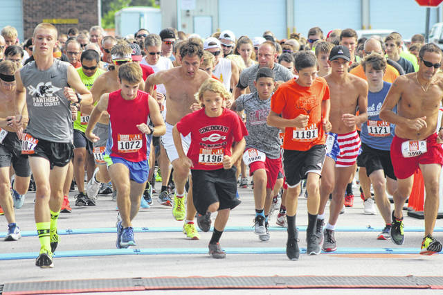 Runners take off from the start line in the 35th annual Firecracker 5k race in Ansonia. Second from left in the red shirt and blue shorts is Adam Klipstine, who in a time of 18 minutes, 8 seconds was the overall male champion for the first time.