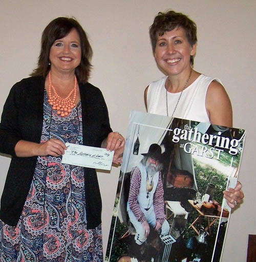 Lisa Martin from Greenville National Bank presents check to Gathering at Garst committee member Katie Gabbard.