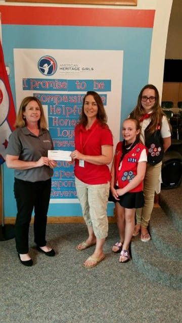 Mercer Savings Bank employee Regina Greber selected American Heritage Girls Troop No. 0724 to receive a $200 donation as part of the bank's Mission of Giving.