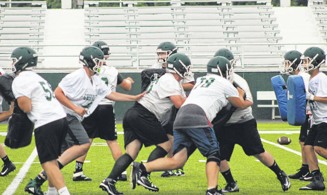 Some Greenville offensive linemen get off the snap of the ball pretty quickly during the first official day of practice Monday at Harmon Field.