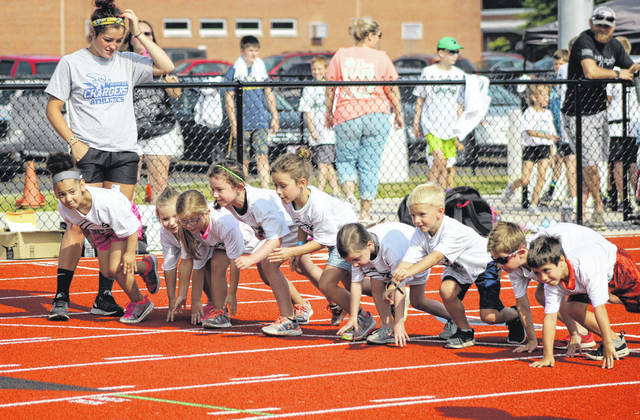 The young campers are ready to get started in the 400-meter dash on the last day of the Greenville Youth Track Camp held last week at the Jennings Center Track & Field Complex.