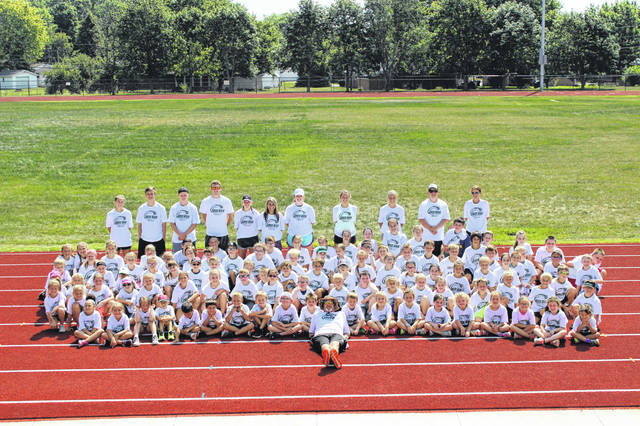 "There were more than 100 youth ages 4-14 participating in the week-long Greenville youth track camp this week at the Jennings Center Track & Field Complex at Greenville High School. At the conclusion of all the running event finals on Thursday, all the participants and coaches gathered for a group photo. GHS track coach Bill Plessinger (lying on the ground in front of the group) said the camp had about 40 participants when he first started it 18 years ago and it has ""just grown and grown"" over the years. Everyone of is high school athletes, he said, have gone through this youth camp. A story including meet results and more photos will appear next week in The Daily Advocate."