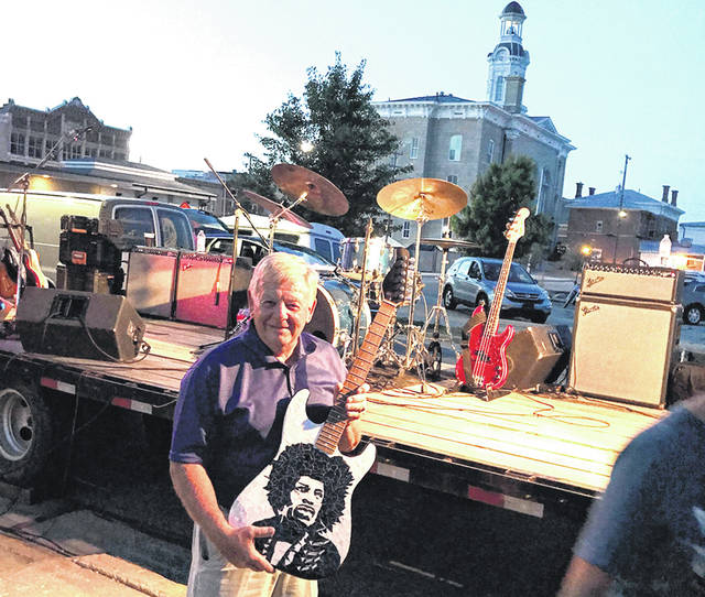 Larry Ullery, of Greenville, won a mosaic guitar created by Bowling Green-area artist Gail Christofferson.