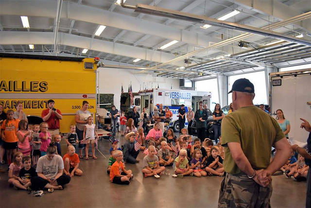 The local police, the volunteer fire department, paramedics and veterans from VFW No. 3849 and American Legion No. 435 attended the Versailles library's Local Heroes Day.