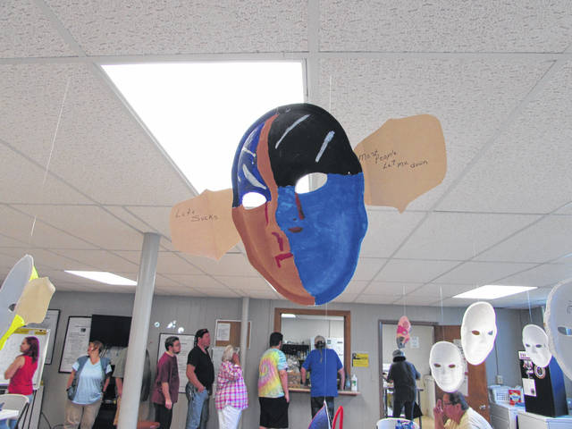 Members of SafeHaven, Inc., painted or otherwise decorated masks to illustrate a number of themes relating to mental illness.