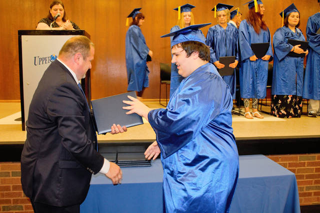 Graduate Keith Parsons of Greenville receives his diploma from Upper Valley Career Center Adult Division Director Scott Naill.
