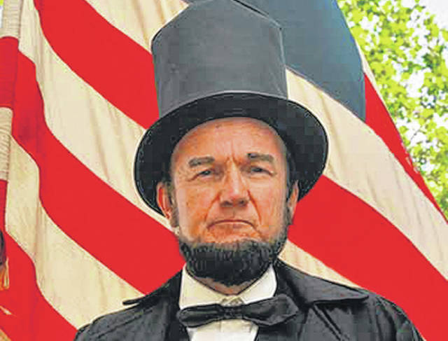 Abraham Lincoln impersonator John Cooper appeared at the Greenville Public Library and the Brethren Retirement Community Friday afternoon.