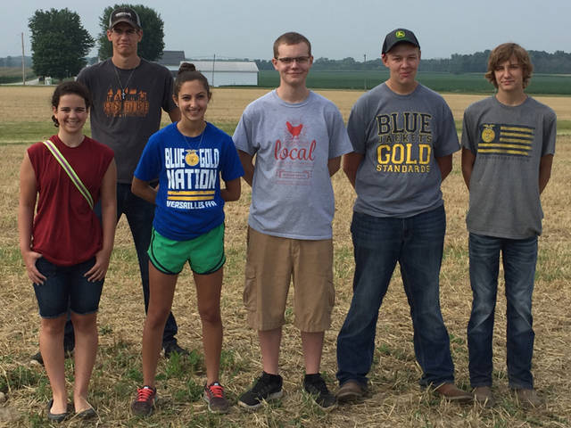 Versailles FFA members (l-r) Abby Petitjean, Grace McEldowney, Marcus Berger, Jacob Wuebker and Kobe Epperly assisted the Ohio Precision Ag with its field day on July 16.
