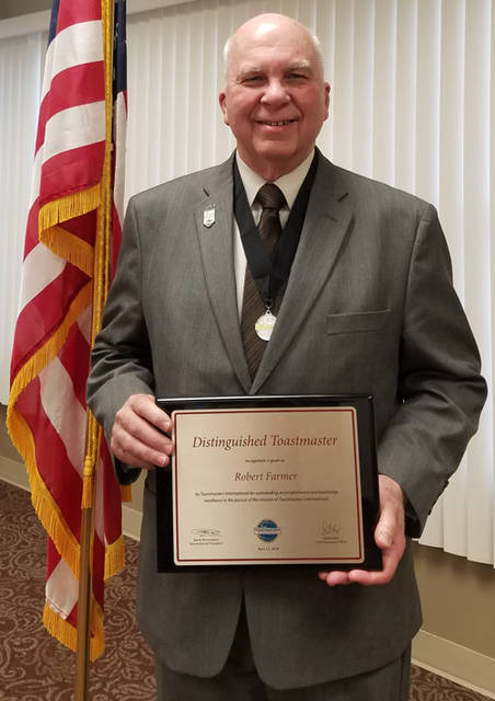 Robert Farmer is pictured with his Distinguished Toastmaster award.