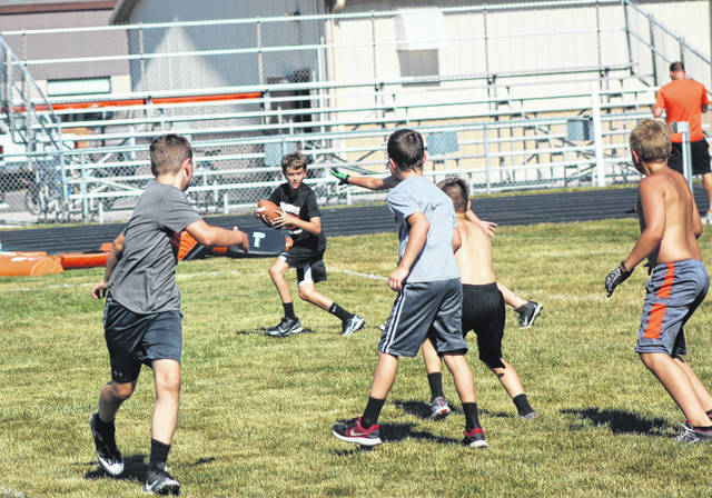 Kids in fourth, fifth and sixth grade played some two-hand touch football games on Tuesday during the second day of instruction at the Future Tigers Youth Football Camp in Versailles.