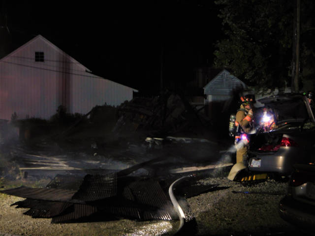 A fire destroyed a garage and also a 2007 Buick that was parked near the garage on Monday in Greenville.