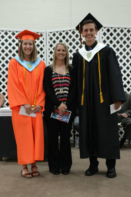 Bradford Class of 2018 graduates Brooke Fair (left) and Johnny Fike (right) received scholarships from the Darke County Foundation. They are pictured with Darke County Foundation scholarship presenter Holly Hill (center).