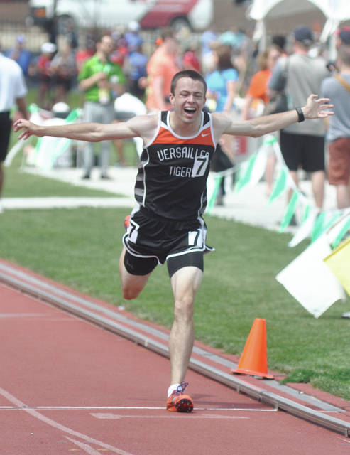Versailles&#8217; Joe Spitzer reacts to winning the 3,200-meter run at the Division II state track and field meet in June. Spitzer recently won the Emerging Elite two-mile run at the New Balance Nationals Outdoors meet in Greensboro, N.C.<h1></h1>