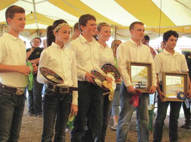 The winner — and five runners-up — of this year's Darke County Junior Fair Showman of Showmen competition.