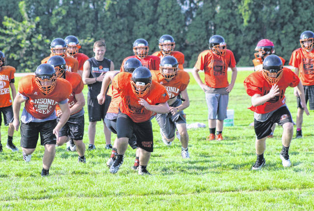 The Ansonia offense runs through a few plays during practice on Thursday.