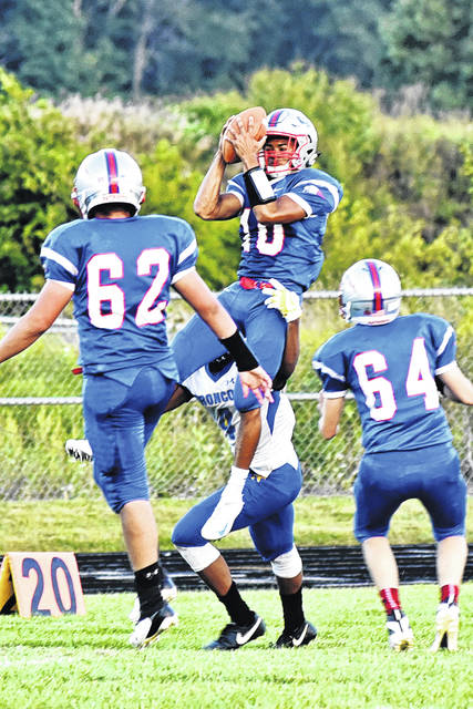 Tri-Village's Austin Bruner (10) goes up high for an interception against the Jefferson Broncos on Friday night. Bruner had three receiving touchdowns in helping lead the Patriots to a 50-12 opening night win.