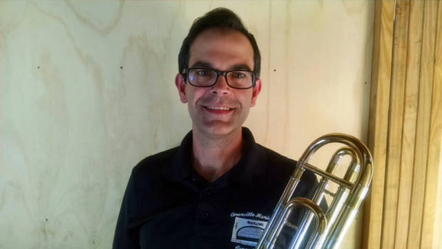 Brian McKibben will be the trombone soloist with the Greenville Municipal Concert Band at 7 p.m. Sunday at the Greenville City Park.