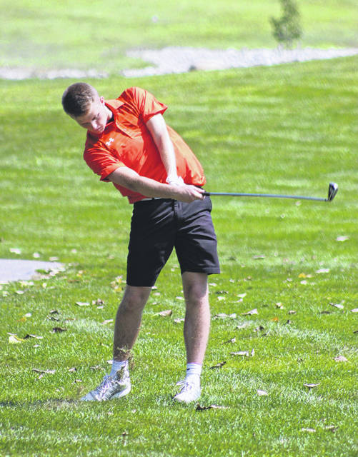 Arcanum's Carter Gray hits his second shot from the fairway of the No. 3 hole on Monday during the Cross County Conference preview tournament at Stillwater Valley Golf Course.
