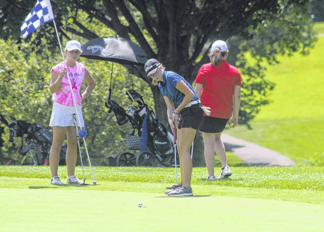 Franklin-Monroe's Claire Haviza putts on the 17th green during the Covington Lady Buccs Invitational on Monday at Echo Hills Golf Course in Piqua. The junior shot an 89 on the day to place fourth overall.