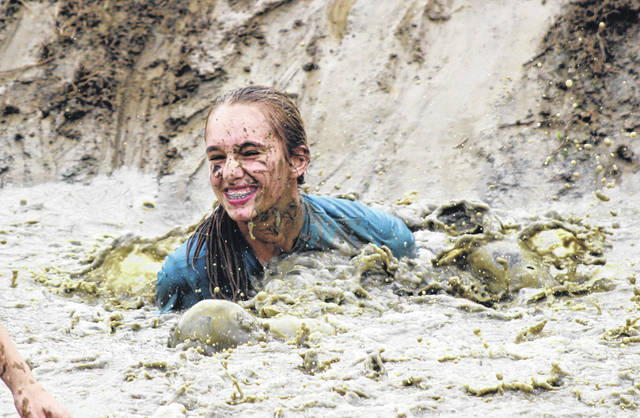 Nearly 700 runners participated in the sixth annual Gauntlet Mud Run on Saturday at Chenoweth Trails. This person came up all smiles after falling into the muddy water at the rope swing.