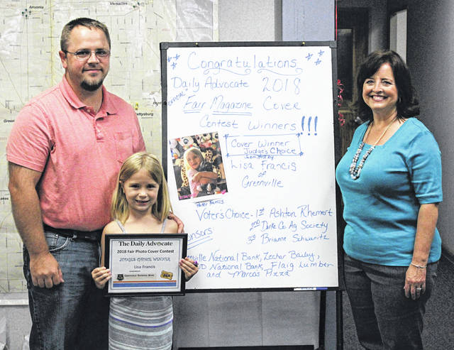 "The Judge's Choice/Cover Winner, sponsored by Greenville National Bank, was a photo submitted by Lisa Francis titled ""Finally popped those balloons!"" The photo features Parker Francis, 7, daughter of Jeff and Rachel Francis. Lisa, Parker's grandmother, received $150 cash and Marco's Pizza for an entire year."