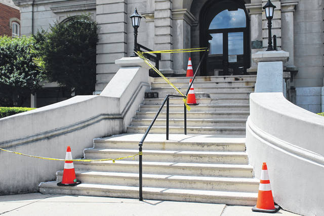 Steps at the front entrance of the Darke County Courthouse are in a dangerous state of disrepair. Judges at the courthouse are seeking greater security improvements in addition to repair of the steps. Both judges and county commissioners have retained legal counsel to discuss.