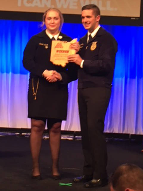 Jamie Hart is shown winning first place at the state FFA convention in the area of Ag Communications Proficiency Award with 2017-18 state FFA President Ryan Matthews. Hart now has been named a top four national FFA proficiency finalist.