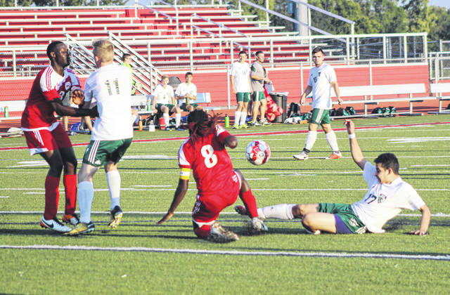 Jorge Guaderrama (17) goes in for a sliding kick during the first half of Greenville's 11-0 win at Trotwood-Madison on Tuesday night. Guaderrama had one goal in the win for the Green Wave.