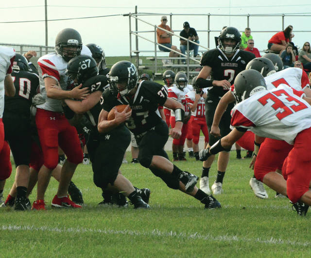 Will Hall (37) finds a hole to run through for Mississinawa Valley in its final scrimmage game Friday night against New Lebanon Dixie.