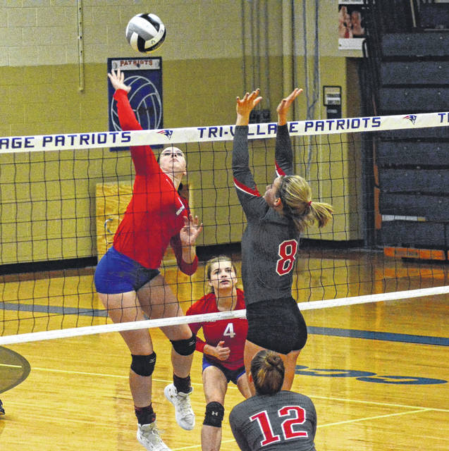 Tri-Village sophomore Maddie Downing goes for a hard smash during a match against Dixie last Thursday. The Patriots defeated the Greyhounds in straight sets.