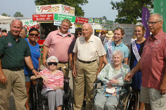 Lucille Thomas (seated left), Roy Weikert (center) and Mildred Dill (seated right) were honored as the oldest fairgoers at the 2018 Darke County Fair. All three of them are 104 years old.