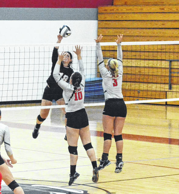 Mississinawa Valley's Sidnie Hunt slams one across the net against Twin Valley South on Thursday night. The Blackhawks won the Cross County Conference match 3-1.