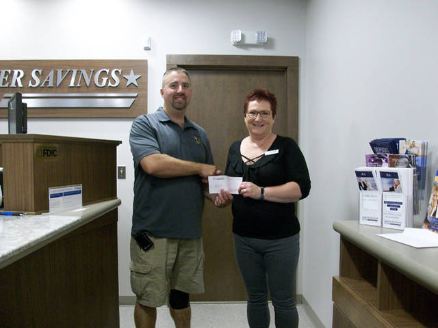 Mercer Savings Bank employee Sheri Brunswick selected St. Henry EMS to receive a $200 donation as part of the bank's Mission of Giving.