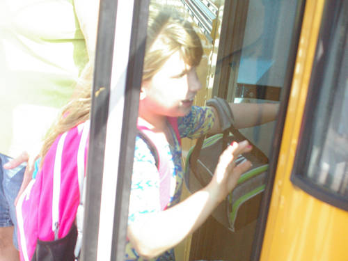 Students get on the bus after the first day of classes for the 2018-19 school year on Monday at Greenville Elementary.