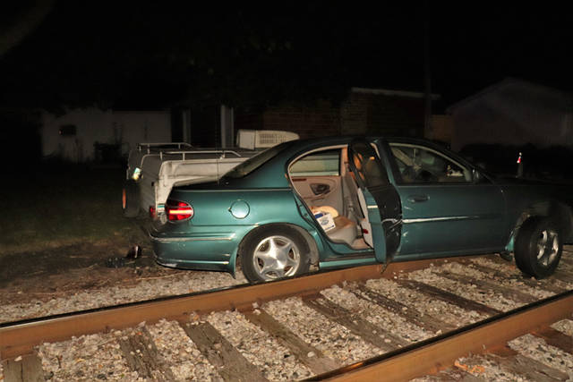 An elderly woman was uninjured when her car became stuck on railroad tracks after failing to realize the road she was traveling on was closed and blocked off to traffic.