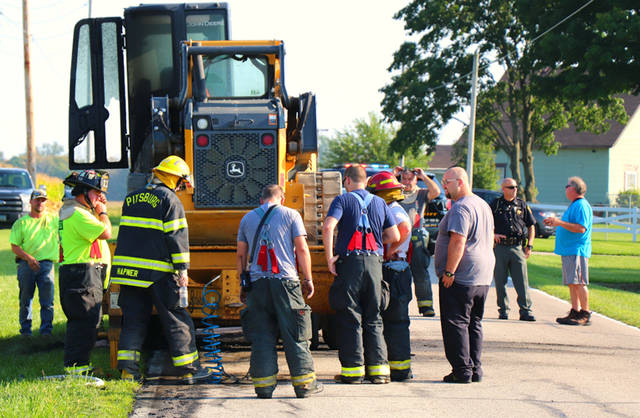 Fire ignited a trailer loaded with a track hoe and skid steer on Monday near Pitsburg.