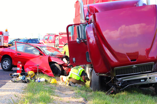 A head-on collision between a car and a semi-tractor and trailer at the intersection of U.S. Route 127 and Kruckeberg Road left three people injured.