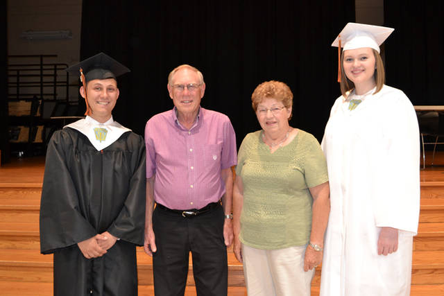 The Steven Stucke Scholarship Fund awarded $1,000-$2,000 scholarships to two Versailles High School graduates pursuing agriculture-related degrees. Pictured (l-r) are Isaac Gehret, donors Melvin and Mary Ann Stucke, and Tessa Tyo.