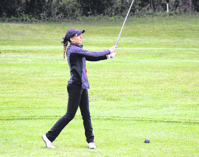 Versailles sophomore Alexis Jay hits her tee shot on the 13th hole Wednesday during the Division II girls sectional tournament at Stillwater Valley Golf Course. Jay shot a 92 to lead the Tigers to a third-place team finish in qualifying to next week's district tournament at Pipestone Golf Course in Miamisburg.