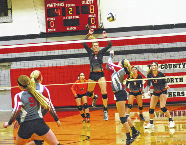 Arcanum's Audrey Heiser (6) goes up for a block during the Trojans match last Thursday at Tri-County North. Arcanum swept the Panthers in three games.