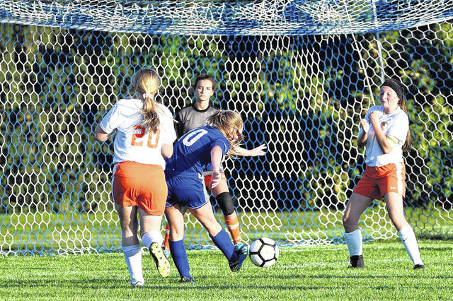 Audrey Cable shoots the ball toward the goal in Franklin-Monroe's 6-0 win over National Trail last Thursday. Cable had two goals in the game.