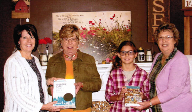 Pictured (l-r) are Julie Strait, co-owner and manager of Bread of Life; Martha Allread; Hannah Wehrley and Vivian Dailey, president of Darke County Weekday Christian Education Inc.