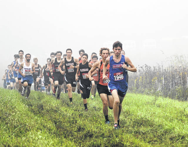 It was a bit foggy at the start of the high school boys race on Saturday morning in the first Blackhawk Invitational held at Chenoweth Trails. Arcanum's Tanner Delk is running in second place at the start, but he would finish as the race champion in 16 minutes, 0.4 seconds.