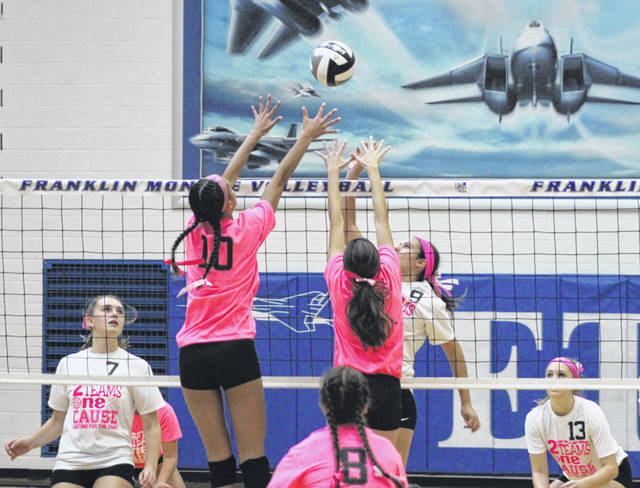 Franklin-Monroe junior Corina Conley (10) goes up for a block with teammate Brigette Filbrun during the Jets home match with rival Arcanum on Saturday. F-M won the match 3-1 to split the season series with the Trojans.