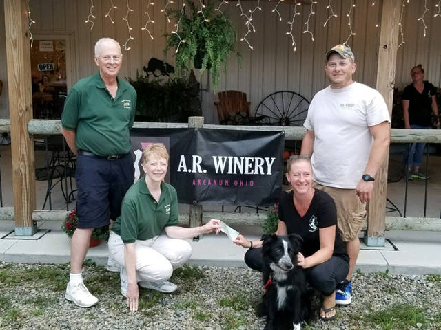 A.R. Winery donated to the Darke County dog park, Scentral Park. Pictured (l-r) are Bob Harshbarger, Jeanie Harshbarger, Fuel, Angie Rex and Russell Rex.